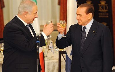 Illustrative: Prime Minister Benjamin Netanyahu (L) and his Italian counterpart Silvio Berlusconi raise their glasses during a state dinner at the King David Hotel in Jerusalem February 1, 2010 (Avi Ohayon/Gpo/Flash 90)
