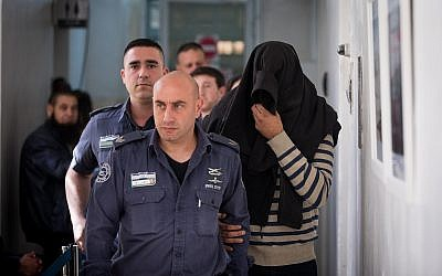 Shlomo Menahem, one of the gas technicians suspected of causing death by negligence at an apartment building in Jerusalem on February 20, 2018, is brought to the Jerusalem Magistrate's Court for extension of his detention on February 21, 2018.  (Yonatan Sindel/Flash90)