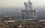 A picture taken from a government-controlled area on the outskirts of Harasta on the northeastern suburbs of Damascus on February 21, 2018, shows smoke rising from areas targeted by Syrian army shelling in the towns of Arbin and Harasta. (AFP PHOTO)