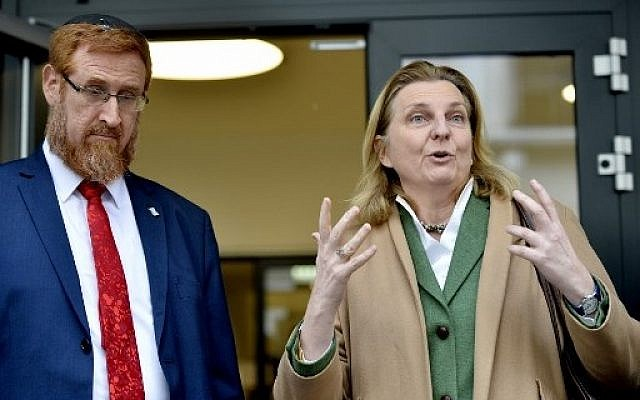 Israeli lawmaker Yehuda Glick (L) stands next to Austrian Foreign Minister Karin Kneissl as they talk to the press as part of a meeting on February 13, 2018 in Vienna, Austria. (AFP PHOTO / APA / HERBERT PFARRHOFER / Austria OUT)