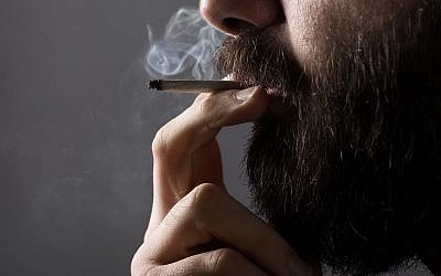 A person smoking marijuana. (Illustrative photo: Mr KornFlakes/iStock by Getty Images)