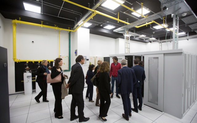 Visitors tour the state-of-the-art data storage facility in Rawabi's tech hub. (Courtesy)