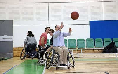 CEO of the American Jewish Joint Distribution Committee (JDC) David M. Schizer at the Spivack gymnasium in Ramat Gan, playing basketball as part of the Israel Unlimited partnership with the Ruderman Family Foundation and Israeli government to empower Israelis with disabilities, February 2018. (JDC)