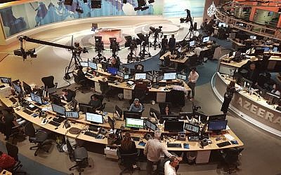 Al Jazeera staff work at their TV station in Doha, Qatar, on June 8, 2017. (AP Photo/Malak Harb)