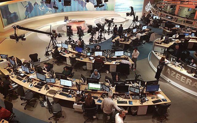 Al Jazeera staff work at their TV station in Doha, Qatar, on June 8, 2017. (AP Photo/Malak Harb)