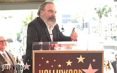'Homeland' actor Mandy Patinkin speaks at a ceremony to unveil his star on the Hollywood Walk of Fame on February 12, 2018. (Screen capture: YouTube via JTA)