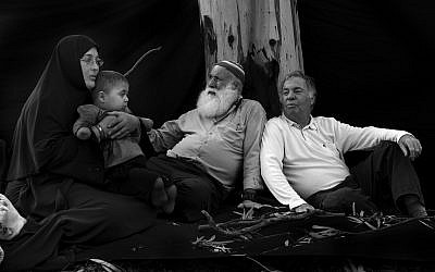 Muhi (second from left), his grandmother, grandfather Abu Naim and Buha, the Israeli activist who helps him (Courtesy Rina Castelnuovo)