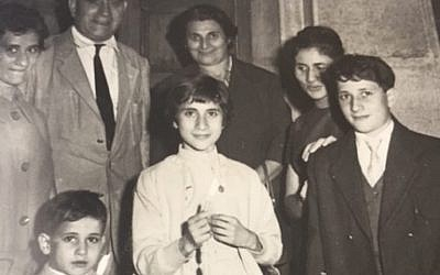 Andre Nathan, who was born the same year that the Nazi-allied Vichy government revoked the French citizenship of Algerian Jews, recalls taking this picture of his parents and siblings outside the Oran synagogue on a Jewish holiday in the 1950s. (Courtesy of Nathan via JTA)