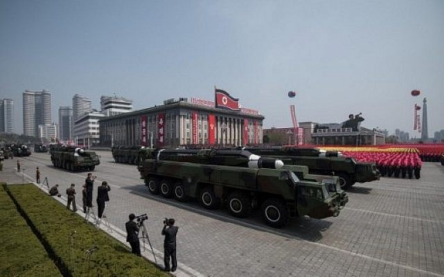 This file photo taken on April 15, 2017, shows an unidentified missile and mobile launcher making its way through Kim Il-Sung Square in Pyongyang, North Korea, during a military parade marking the 105th anniversary of the birth of late North Korean leader Kim Il-Sung in Pyongyang. (AFP Photo/Ed Jones)