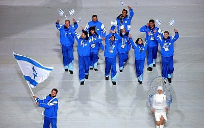 Short track speed skater Vladislav Bykanov, lower left, leading the Israeli Olympic team at the opening ceremony of the Winter Olympics in Sochi, Russia, February 7, 2014. (Quinn Rooney/Getty Images/via JTA)