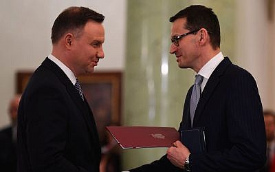 Polish President Andrzej Duda, left, nominating Mateusz Morawiecki to be prime minister at the presidential palace in Warsaw, December 11, 2017. (Janek Skarzynski/AFP/Getty Images via JTA)