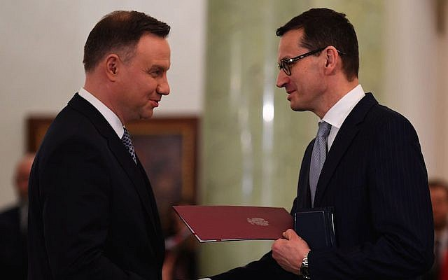 "Polish President Andrzej Duda, left, nominating Mateusz Morawiecki to be prime minister at the presidential palace in Warsaw, Dec. 11, 2017. Both support the controversial law on the term ""Polish death camps."" (Janek Skarzynski/AFP/Getty Images via JTA)"