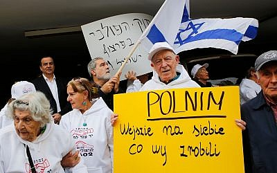 Holocaust survivors protesting Poland's new bill on Holocaust rhetoric in front of the Polish Embassy in Tel Aviv, February 8, 2018. (Gil Cohen-Magen/AFP/Getty Images/via JTA)