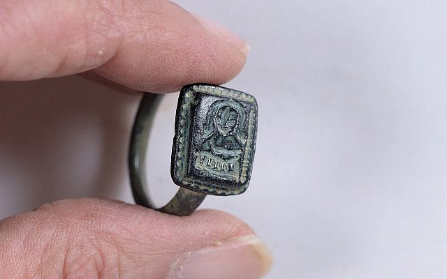 The ring found by gardener Dekel Ben-Shitrit thought to depict St. Nicholas with a bishop's crook. (Clara Amit, Israel Antiquities Authority)