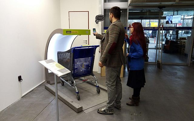 Photo of shoppers in Prague using Supersmart technology at a grocery store. (Courtesy)
