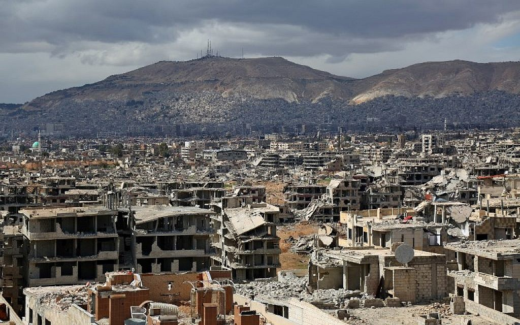 A picture taken on February 27, 2018, shows a view of the rebel-held neighborhood of Jobar, on the eastern edge of the Syrian capital Damascus, following a reported regime bombardment, with Mount Qasioun seen in the background. (AFP Photo/Ammar Suleiman)