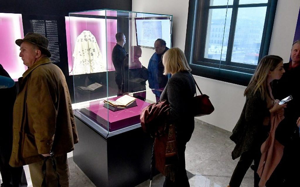 This photograph taken on February 22, 2018, shows visitors to The National Museum of Bosnia and Herzegovina, in Sarajevo, which has revealed a new space intended for keeping one of museum's most valuable items, the famous Sarajevo Haggadah. (AFP PHOTO / ELVIS BARUKCIC)
