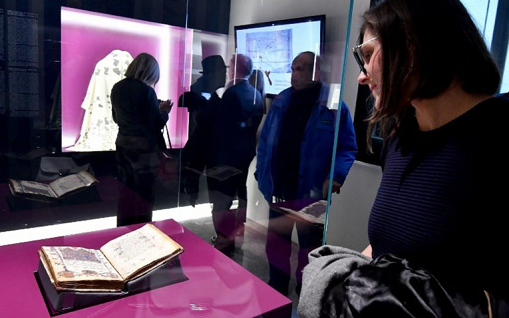 This photograph taken on February 22, 2018, shows visitors to The National Museum of Bosnia and Herzegovina, in Sarajevo, which has revealed a new space intended for keeping one of museum's most valuable items, the famous Sarajevo Haggadah. (AFP/Elvis Barukcic)