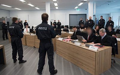 "Picture taken on June 30, 2017 at a courtroom inside a correctional facility in Dresden, eastern Germany, shows defendants of the so-called ""Freital group"" accused of attacking refugee shelters and political opponents during their trial. (AFP PHOTO / dpa / Sebastian Kahnert)"
