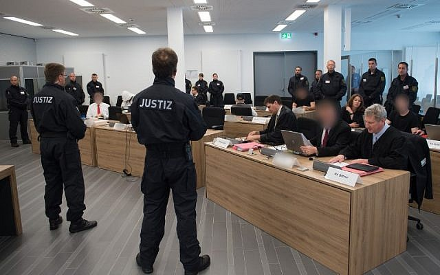 """Picture taken on June 30, 2017 at a courtroom inside a correctional facility in Dresden, eastern Germany, shows defendants of the so-called """"Freital group"""" accused of attacking refugee shelters and political opponents during their trial. (AFP PHOTO / dpa / Sebastian Kahnert)"""