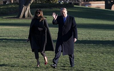 US President Donald Trump waves to reporters as he walks into the East Wing of the White House with First Lady Melania Trump after arriving at the White House on Marine One on March 3, 2018 in Washington, DC.  (AFP /Alex Edelman)