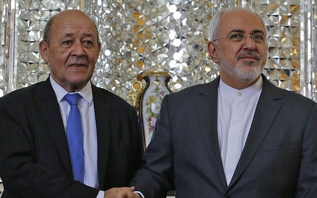 Iran's Foreign Minister Mohammad Javad Zarif (R) shakes hands with French Foreign Minister Jean-Yves Le Drian as they meet in the capital Tehran on March 5, 2018. (AFP/Atta Kenare)