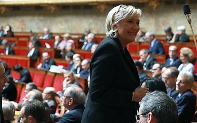Head of the far-right National Front party Marine Le Pen attends a session of questions to the government at the French National Assembly in Paris on March 6, 2018. (AFP Photo/Jacques Demarthon)