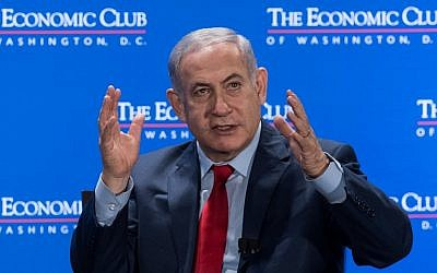 Prime Minister Benjamin Netanyahu addresses the Economic Club of Washington in Washington, DC, on March 7, 2018. (AFP PHOTO / NICHOLAS KAMM)