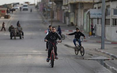 Palestinian boys ride bicycles in Gaza City on March 8, 2018. (AFP/ MOHAMMED ABED)