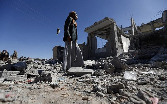 Yemenis check the damage in the aftermath of a reported air strike by the Saudi-led coalition in the Yemeni capital Sanaa on March 8, 2018. (AFP PHOTO / Mohammed HUWAIS)