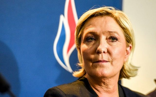 National Front leader Marine Le Pen attends the far-right party's annual congress in the French city of Lille on March 10, 2018. (AFP Photo/Philippe Huguen)