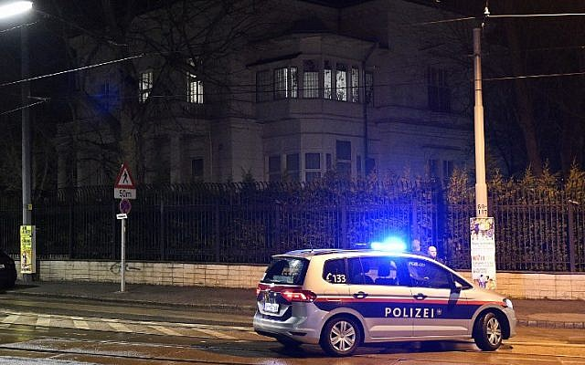 Illustrative: Police officers gather outside the Iranian ambassador's residence after an attack in Vienna, Austria, on March 12, 2018. (AFP Photo/APA/Hans Punz)