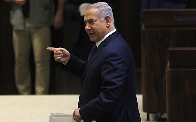 Prime Minister Benjamin Netanyahu gestures during a Knesset plenum session on March 12, 2018. (AFP Photo/Menahem Kahana)