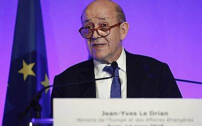 French Foreign Affairs Minister Jean-Yves Le Drian speaks to the press during a joint press conference with German Foreign Affairs Minister at The French Foreign Ministry in Paris on March 14, 2018. (AFP/Thomas Samson)