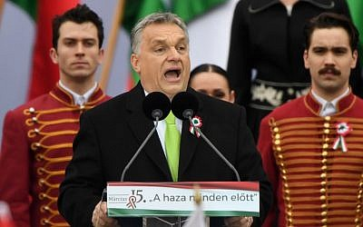 Hungarian Prime Minister Viktor Orban delivers a speech in front of the Hungarian Parliament in Budapest on March 15, 2018, during the official commemoration of the 170th anniversary of the 1848-1849 Hungarian revolution. (AFP Photo/Attila Kisbenedek)