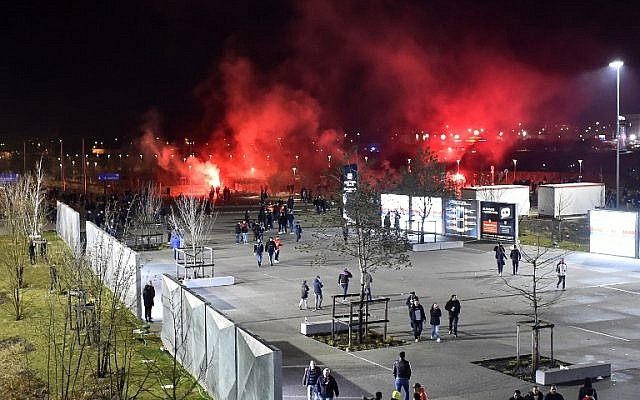 Lyon's fans use red flares before before the Europa League football match Olympique Lyonnais (OL) vs CSKA Moscow, on March 15, 2018, at the Groupama Stadium in Decines-Charpieu, central-eastern France. (AFP PHOTO / ROMAIN LAFABREGUE)
