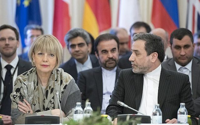 Abbas Araghchi (R), political deputy at the Ministry of Foreign Affairs of Iran, and the Secretary General of the European Union External Action Service (EEAS) Helga Schmid attend E3/EU+3 and Iran talks at Palais Coburg in Vienna, Austria on March 16, 2018. (AFP/Joe Klamar)