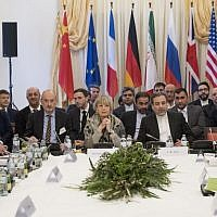 Abbas Araghchi (C-R), political deputy at the Ministry of Foreign Affairs of Iran, and the Secretary General of the European Union External Action Service (EEAS) Helga Schmid (C-L) along with delegates attend E3/EU+3 and Iran talks at Palais Coburg in Vienna, Austria on March 16, 2018. (AFP PHOTO / JOE KLAMAR)