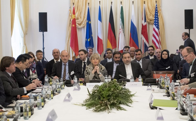 Abbas Araghchi, political deputy at the Ministry of Foreign Affairs of Iran and the Secretary General of the European Union External Action Service Helga Schmid along with delegates attend E3/EU+3 and Iran talks at Palais Coburg in Vie