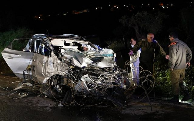 Israeli security forces and forensics experts inspect the destroyed vehicle that was used by a Palestinian terrorist in a car ramming attack on Israeli soldiers near West Bank settlement of Mevo Dotan on March 16, 2018. (AFP Photo/Jack Guez)