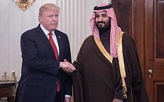 US President Donald Trump and Saudi Deputy Crown Prince, left, and Saudi Defense Minister Mohammed bin Salman, who later that year became Crown Prince of Saudi Arabia, shaking hands in the State Dining Room before lunch at the White House in Washington, DC,  March 14, 2017. (NICHOLAS KAMM/AFP)