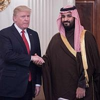 This file photo taken on March 14, 2017 shows US President Donald Trump and Saudi Deputy Crown Prince and Defense Minister Mohammed bin Salman shaking hands in the State Dining Room before lunch at the White House in Washington, DC. ( AFP PHOTO / NICHOLAS KAMM)