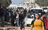 Syrian civilians fleeing the city of Afrin in northern Syria are seen as they enter the town of Tal Rifaat in the government-controlled part of the northern Aleppo province, on March 18, 2018. (AFP PHOTO / George OURFALIAN)