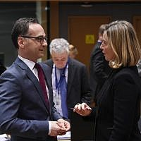German Minister of Foreign Affairs Heiko Maas, left, speaks with High Representative of the Union for Foreign Affairs and Security Policy Federica Mogherini ahead of a Foreign Affairs minister meeting at EU headquarters in Brussels on March 19, 2018. (AFP/JOHN THYS)