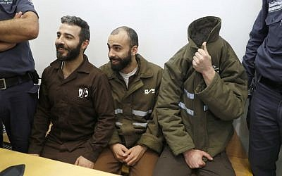 French national Romain Franck (R), then 24, a worker at the French consulate, and Palestinians Moufak al-Ajluni (L) and Mohamed Katout (C) appear in court in the Israeli city of Haifa on March 19, 2018, to face charges of smuggling guns from Gaza. (AFP Photo/Jack Guez)