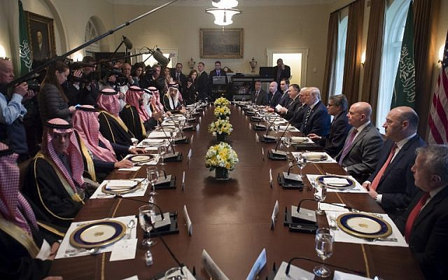US President Donald Trump (center right) holds a lunch meeting with Saudi Arabia's Crown Prince Mohammed bin Salman (center left) and members of his delegation in the White House Cabinet Room on March 20, 2018. (AFP Photo/Saul Loeb)