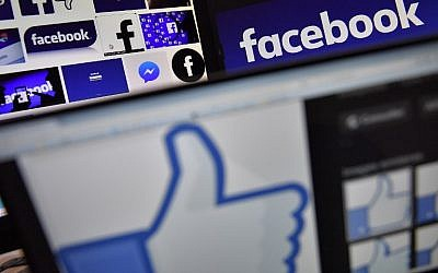 This file photo taken on November 20, 2017 shows logos of US online social media and social networking service Facebook. (AFP Photo/Loic Venance)