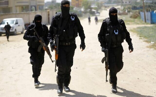 Hamas policemen carry out a raid in Nuseirat, south of Gaza City on March 22, 2018, that resulted in the arrest of a suspect in a recent bomb attack against the Palestinian prime minister, officials said. ( AFP PHOTO / MOHAMMED ABED)