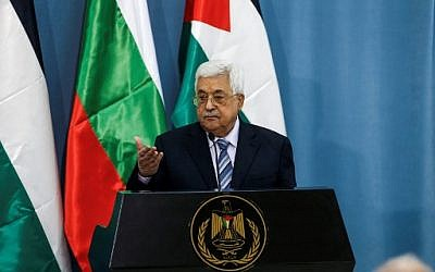Palestinian Authority President Mahmoud Abbas gestures with his hand during a joint press conference with the visiting Bulgarian president at the Palestinian Authority headquarters in the West Bank city of Ramallah on March 22, 2018. (AFP PHOTO / ABBAS MOMANI)