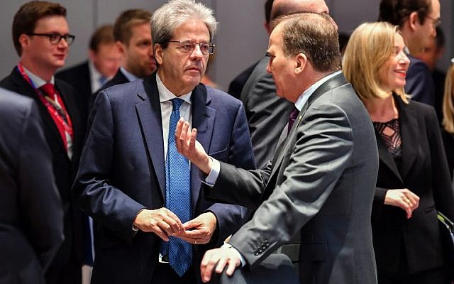 Italy's Prime Minister Paolo Gentiloni (L) talks with Sweden's Prime Minister Stefan Lofven on the second day of a summit of European Union leaders at the European Council headquarter in Brussels, on March 23, 2018. (AFP PHOTO / POOL / Geert Vanden Wijngaert)